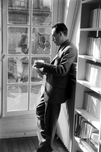 Subject: French writer Albert Camus reading outside his publishing firm office. Paris, France 1957 Photographer- Loomis Dean Time Inc Owned merlin- 16915575